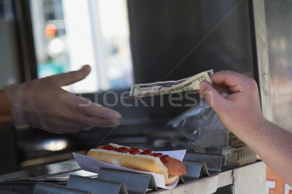 Paying for purchased hot dog Stock photo © frank11