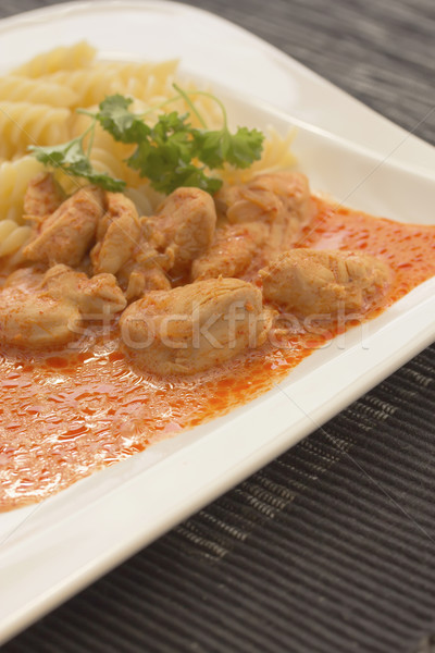 Chicken pieces with Pasta in Paprika Cream Sauce Stock photo © frank11