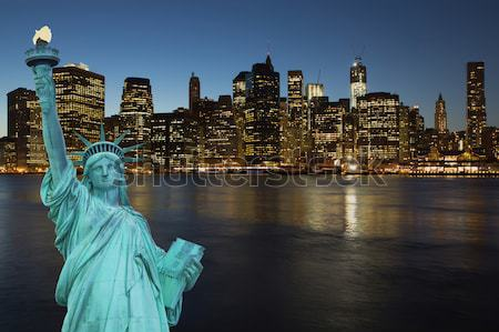Lower Manhattan at night with Statue of LIberty Stock photo © frank11