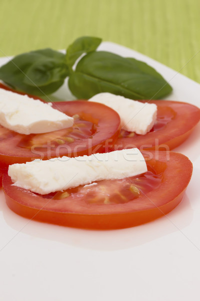 Salad of tomatoes, cheese and basil. Vertically. Stock photo © frank11