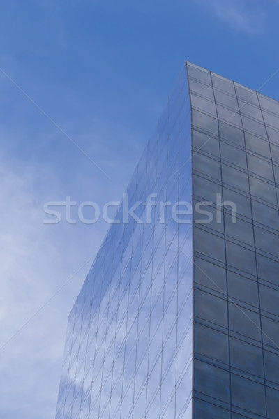 Skyscraper with clouds reflection Stock photo © frank11