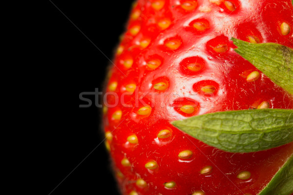 Macro view of fresh strawberry on a black background.  Stock photo © frank11