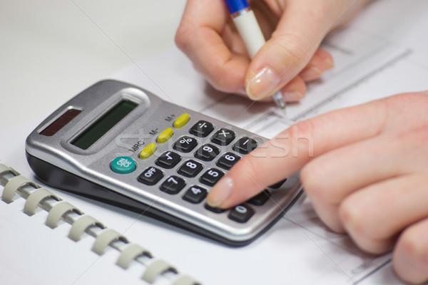 Woman's hands counting on calculator Stock photo © frank11