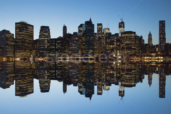 Alsó Manhattan sziluett naplemente tükröződés New York Stock fotó © frank11