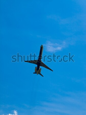 A Commercial Airliner Taking Off into a Partly Cloudy Blue Sky Stock photo © Frankljr