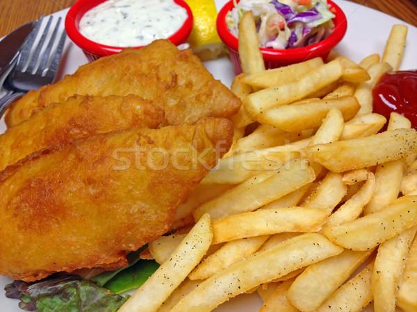 Tányér leharcolt sült hal sültkrumpli mártás Stock fotó © Frankljr
