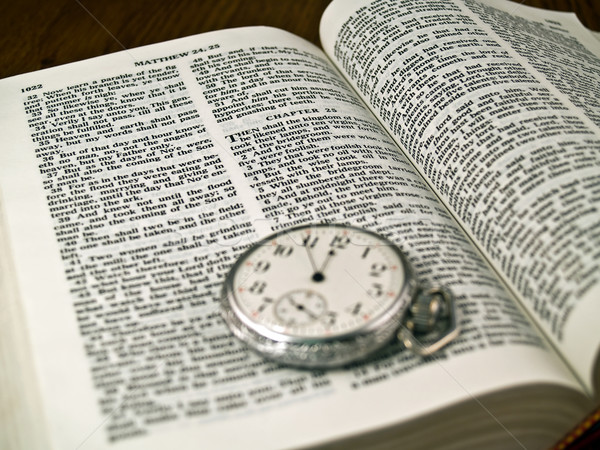The Bible opened to Matthew 24: 36 with a Pocketwatch Stock photo © Frankljr