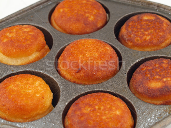 A Pan of Freshly Cooked Aebelskivers Awaiting Garnish Stock photo © Frankljr