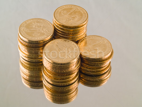 Four stacks of new gold US Dollar Coins all showing the Statue of Liberty. Stock photo © Frankljr