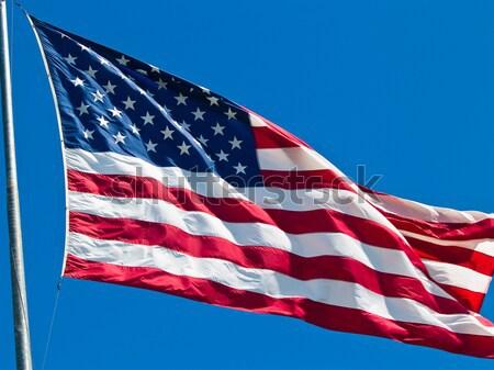 Amerikai zászló integet szeles nap felirat kék Stock fotó © Frankljr