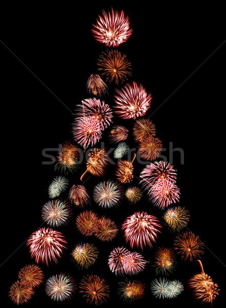 A Christmas Tree Made of Firework Bursts on a Black Background Stock photo © Frankljr