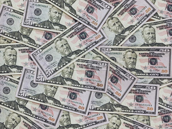 Stock photo: A Pile of Fifty Dollar Bills as a Money Background