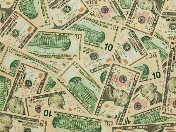 A Pile of Ten Dollar Bills as a Money Background Stock photo © Frankljr