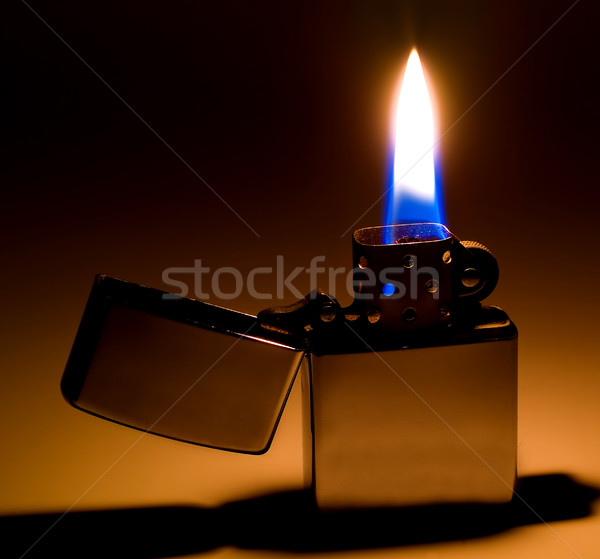 Classic Flip Top Lighter with Flame and Shadow Stock photo © Frankljr