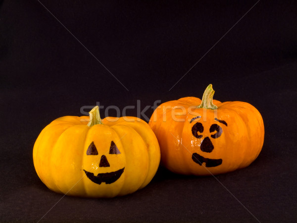 Mini Pumpkins with Funny Faces with a Black Cloth Background Stock photo © Frankljr