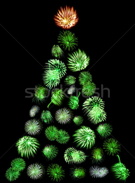 A Christmas Tree Made of Green Firework Bursts on a Black Background Stock photo © Frankljr