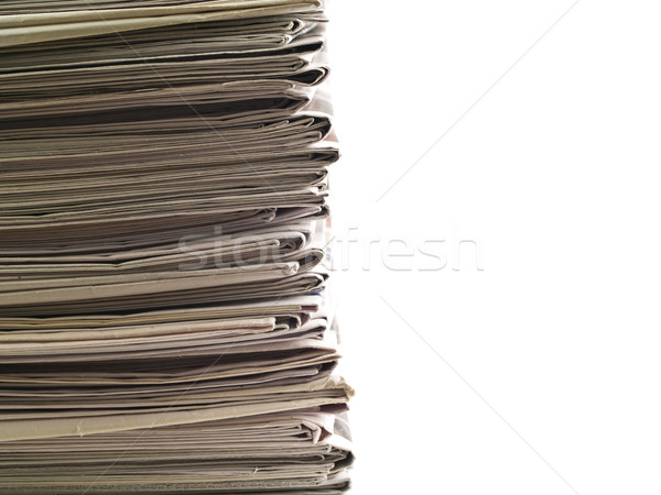 Stock photo: Old newspapers stacked from the top to bottom
