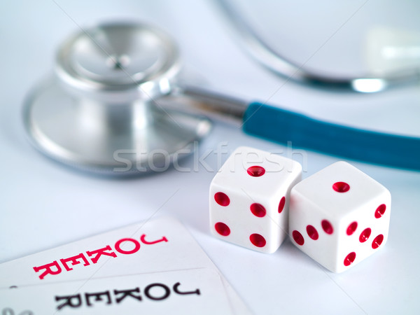 Joking with Your Health Dice Jokers and Stethoscope Stock photo © Frankljr