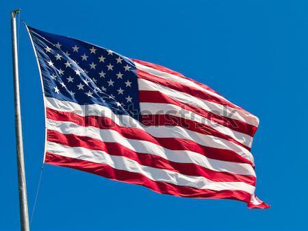 Amerikan bayrağı rüzgârlı gün imzalamak mavi Stok fotoğraf © Frankljr
