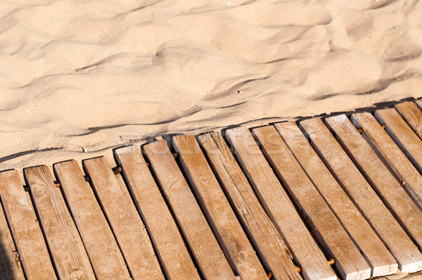Stock photo: Weathered wooden boardwalk on sand