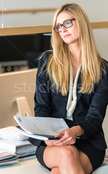 Businesswoman In Office Working On A Document Stock photo © franky242