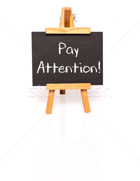 Pay attention. Blackboard with text and easel. Stock photo © franky242
