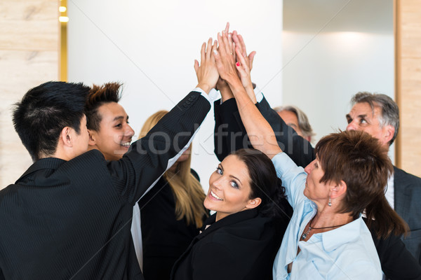 Teamwork - business people with joint hands in the office Stock photo © franky242