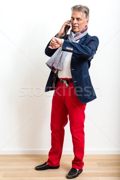 пенсионер мобильного телефона студию портрет привлекательный Сток-фото © franky242