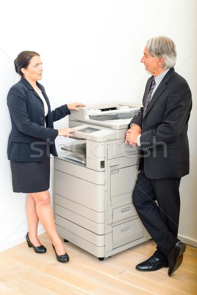 Colleagues talking at  copying machine in the office Stock photo © franky242