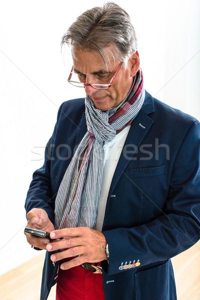 Elegáns nyugdíjas mobiltelefon stúdió portré vonzó Stock fotó © franky242