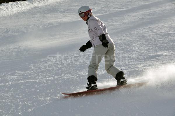 Female snowboarder in powder snow Stock photo © franky242