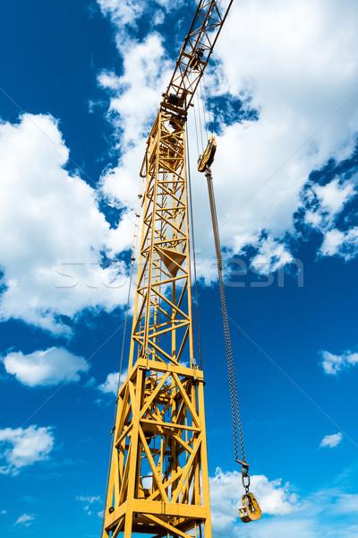 Amarelo construção guindaste pormenor azul Foto stock © franky242