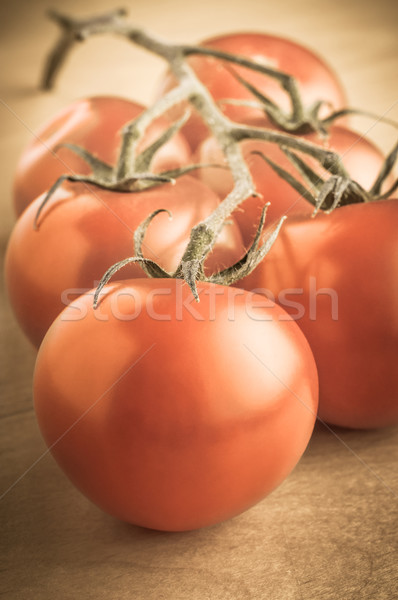 Vintage Vine Tomatoes on Table Stock photo © frannyanne