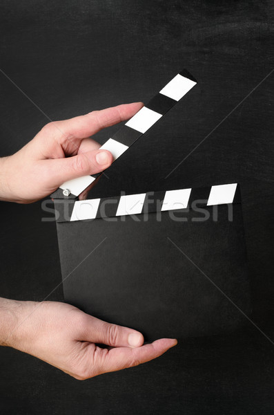 Hands Holding Clapperboard Stock photo © frannyanne