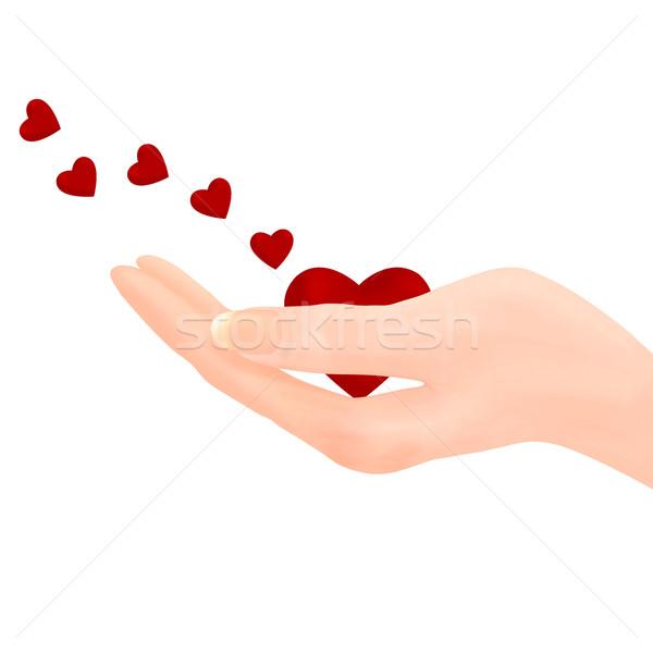 Holding heart - Sending Love Stock photo © frannyanne