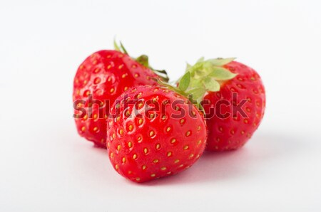 Three Strawberries Grouped Stock photo © frannyanne