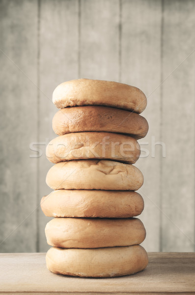 Tall Stack of Bagels on Wood with Planked Background - Filtered Stock photo © frannyanne