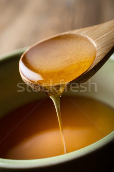 Miel cuchara de madera tazón borde verde Foto stock © frannyanne