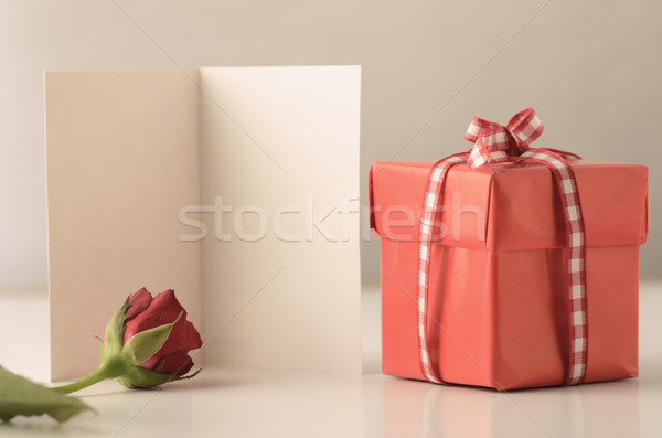 Single Gift Box with Red Rose and Card Stock photo © frannyanne