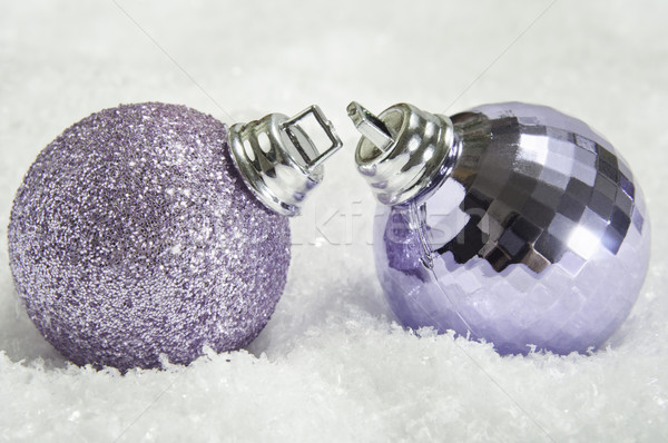 Pair of Christmas Baubles on Snow Stock photo © frannyanne