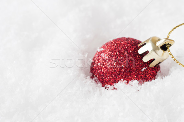 Red Glitter Bauble in Snow Stock photo © frannyanne