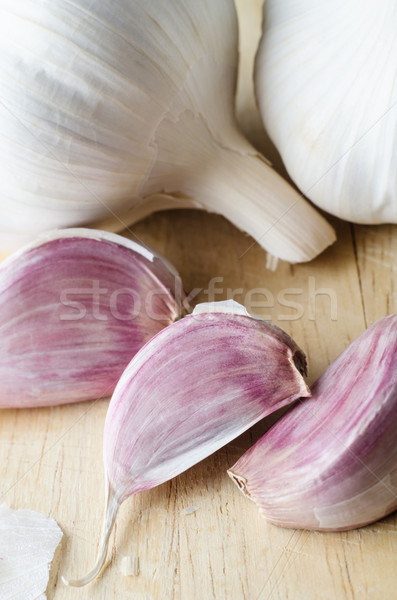 Garlic Bulbs and Cloves on Chopping Board - Close Up Stock photo © frannyanne