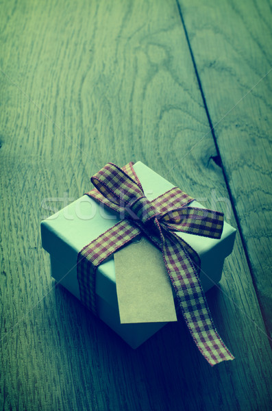 Single Gift Box with Gingham Ribbon and Blank Label on Wood - Cr Stock photo © frannyanne