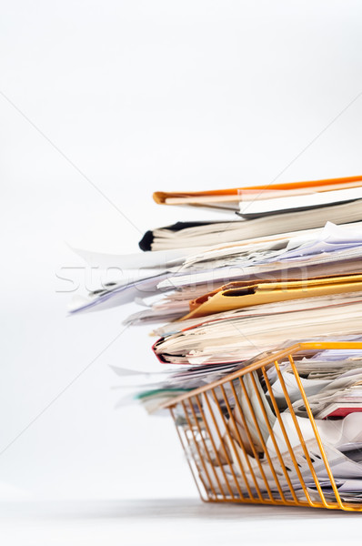 Office Tray Piled High with Messy Documents at Angle Stock photo © frannyanne