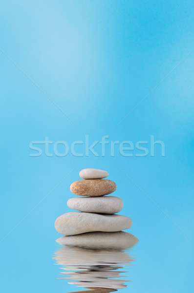 Stacking Stones on Watery Reflection with Blue Sky Stock photo © frannyanne