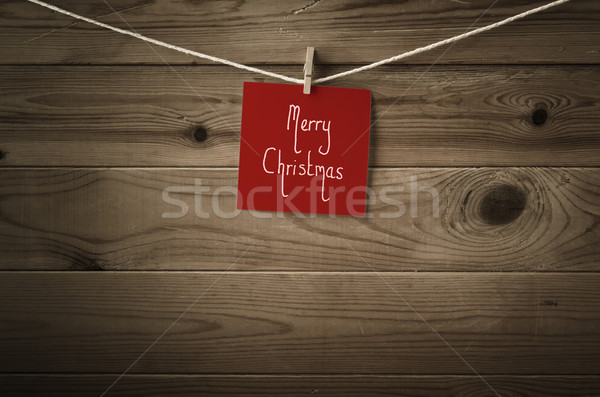 Merry Christmas Message on Red Note Paper Pegged to String again Stock photo © frannyanne