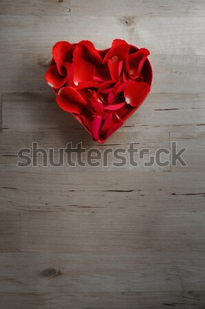 Rose Petals in Heart Shaped Bowl on Wood from Above Stock photo © frannyanne