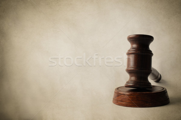 Gavel on Block with Aged Parchment Background Stock photo © frannyanne