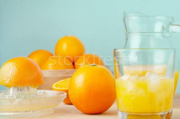 Freshly Squeezed Orange Juice in Progress on Wooden Table Stock photo © frannyanne