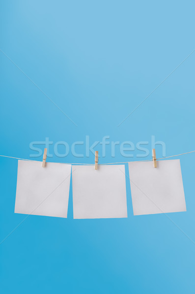 Three Blank Notes Pegged on Washing Line in Blue Sky Stock photo © frannyanne